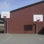 2 Basketball hoops at different heights for younger students.