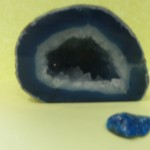Image of a blue geode with a small, smooth blue gem.