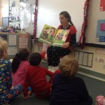 Guest reader sharing a book with a classroom of students.