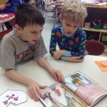 Two boys reading together in an elementary school.
