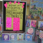 Sign and self-portrait boxes at the school entrance for Art's Night 2014.