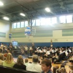 Picture of Chorus and Band in the Gym at the beginning of the Art's Night music performances.