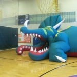 Dinosaur where Dinoman instructs students inside the inflatable dino-creature.