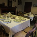 Typical boarding house dining room setup for supper with china and silverware for the Yankee Mill Girls.