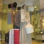 Display of a typical Mill Girl with shopping bags.