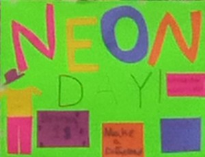 A bright neon green poster that reads Neon Day.
