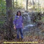 Picture of Melissa Stewart walking in the woods.
