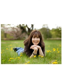 Author, Jacqueline Davies, laying in a field - press photo.