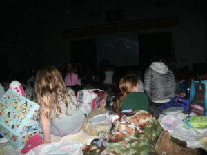 Students in the dark watching the movie
