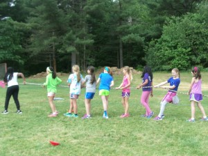 Some 4th graders participating in a tug-a-war competition.