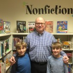 Mr. Keohane and the Chickering Reporters in the school library.