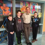 Mr Harte with 3 Chickering reporters outside the computer lab.