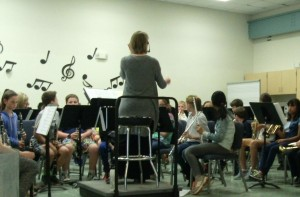 Mrs. Barry seated, talking to the 4th grade band students.