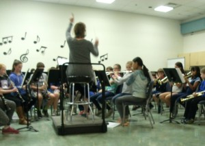 Mrs. Barry Conducting Chanton Canon, a song 4th grade band plays.