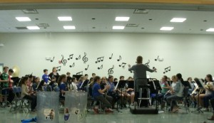 4th grade band practicing on the stage in the cafeteria.