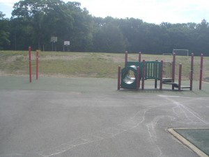 Picture of some of the new preschool playground equipment ... tunnel and bridge.