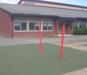Preschool Playground and two red posts, which will house the new swing.