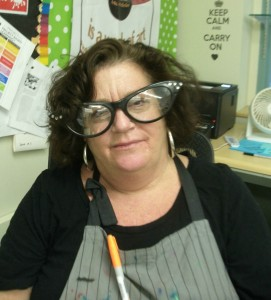 Our Art teacher, Mrs. Pelletier wearing large, funny glasses.