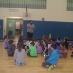 Image of Mr. Fraser instructing his students in the gym.