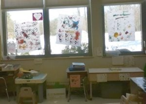 Artwork created by children making different colored hand prints.