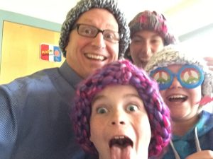 Our Teacher and 3 students wearing their newly traded homemade hats.